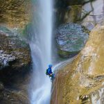 Canyoner abseiling a large waterfall