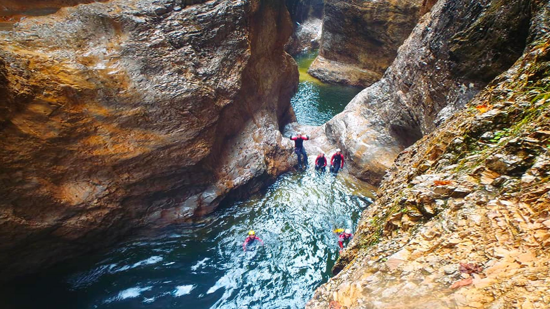 Canyoners swimming in a gorge