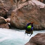 Canyoner crossing on a rope a white water canyon