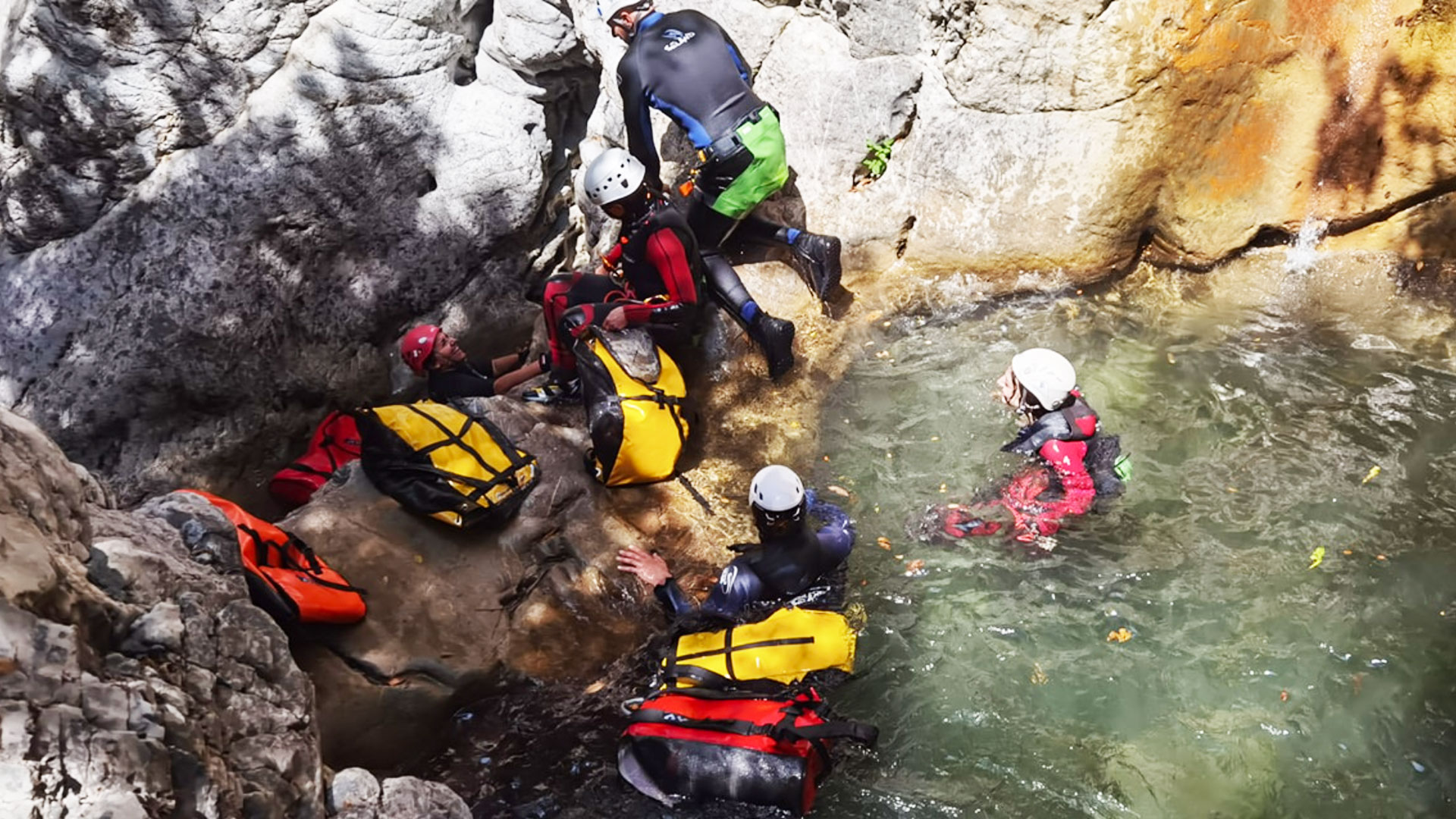 A group of canyoners in a water pond