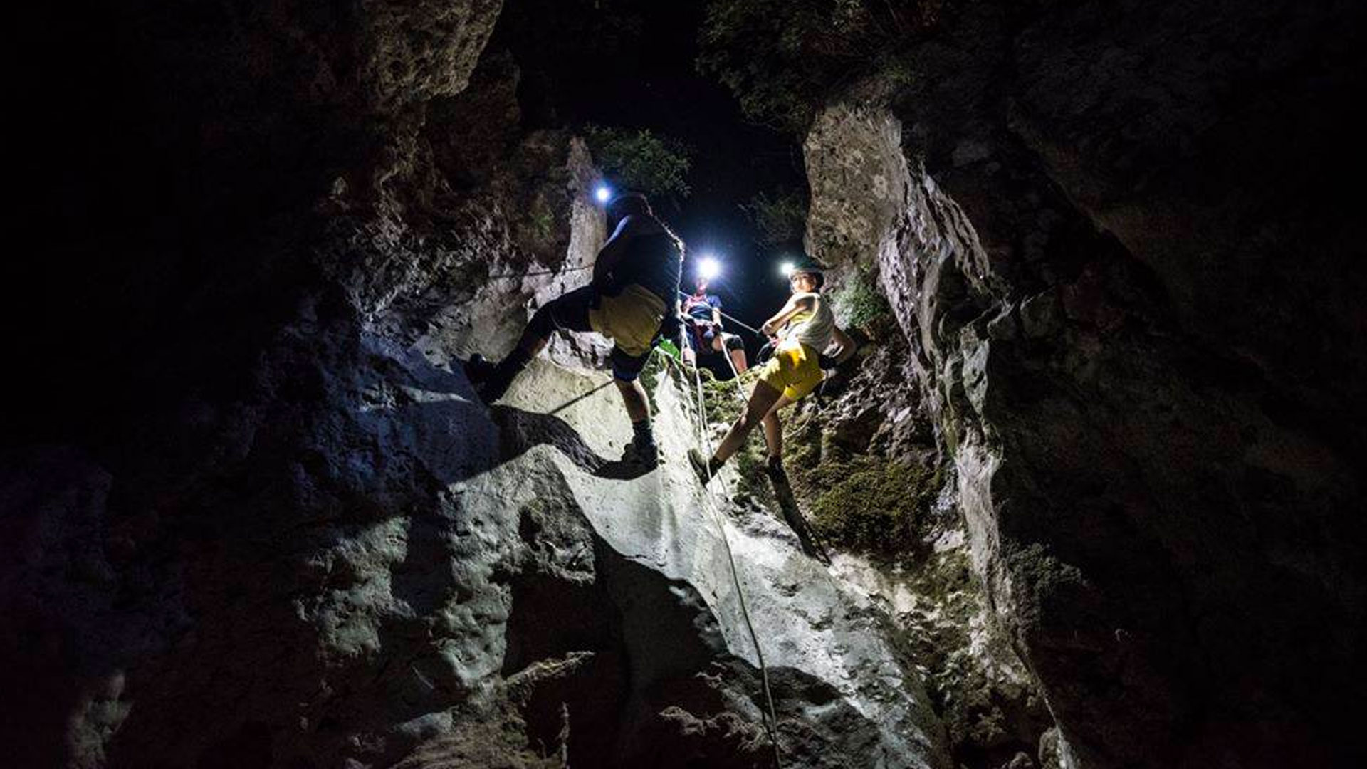 Canyoners during a night descent rappelling