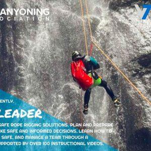 Canyoner descending a waterfall