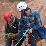 Two canyoners practicing a rescue technique