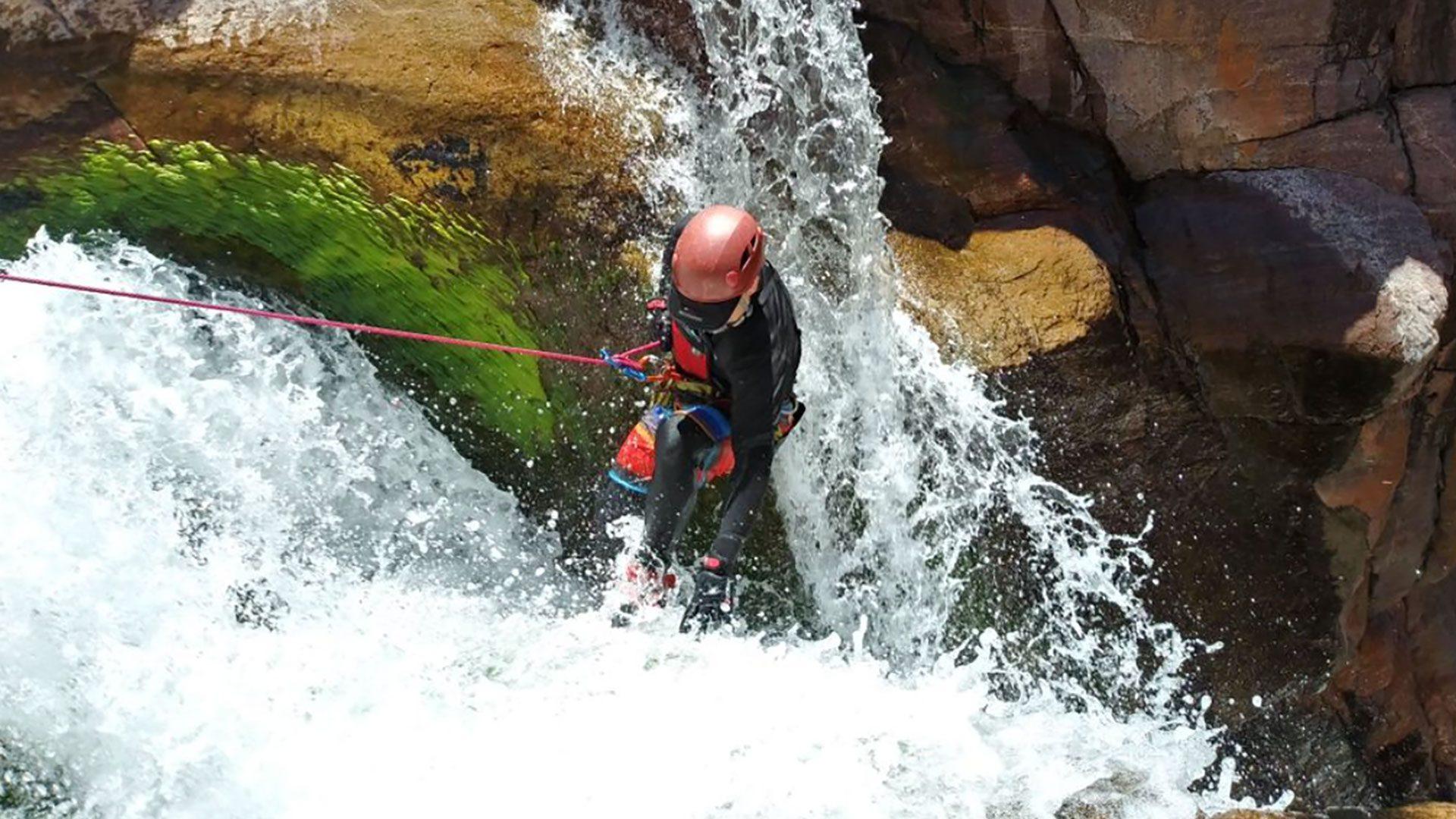 Canyoner descending a waterfall in Christopher Creek Arizona